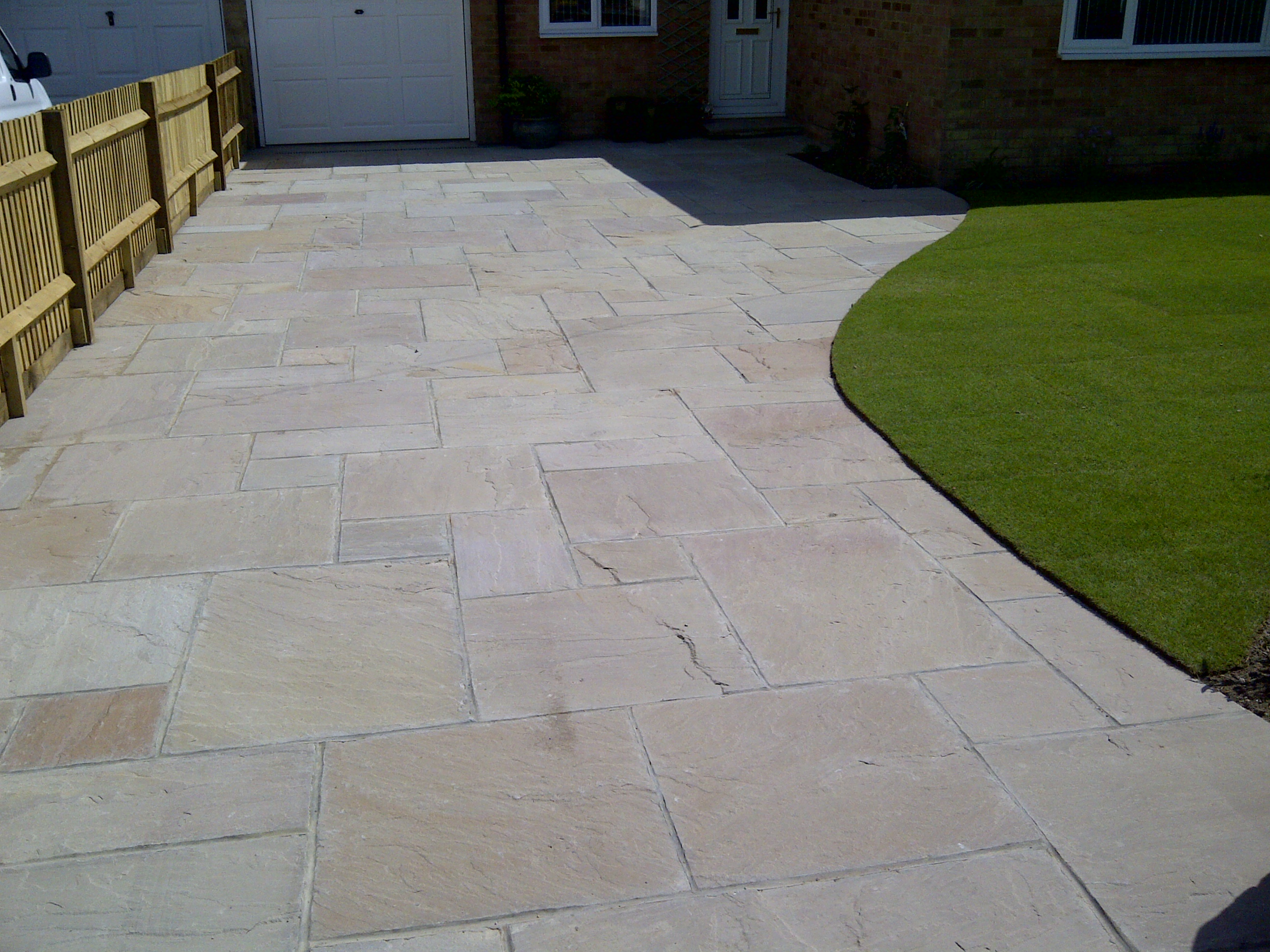 Indian flagstone drive laid over reinforced concrete