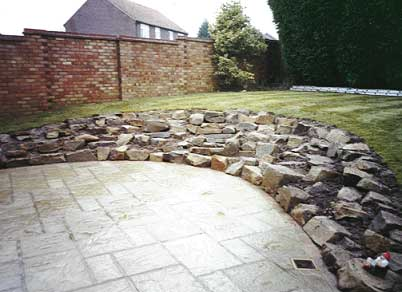 Man made paving and rockery